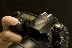 Finger-deprimierender Kameraverschluss-Knopf Stockbilder