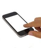 Finger, der auf modernes smartphone zeigt Lizenzfreie Stockfotos