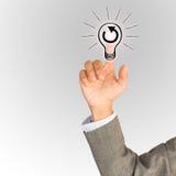 Finger des Geschäftsmannklicken-Ideenkonzeptes Stockfotos