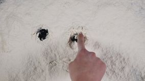 Finger drawing funny smiley on a white flour background. top view 4k.  stock video footage