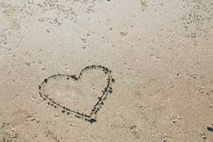 Finger drawn heart love symbol on sea beach. Sand holiday summer concept Stock Image