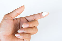 Finger. With drops of ointment Stock Photos