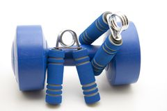 Finger dumbbells with blue grip Royalty Free Stock Photography