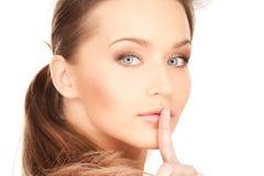 Finger en los labios Imagen de archivo libre de regalías