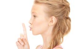 Finger en los labios Imagen de archivo