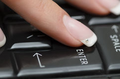 Finger on Enter Button Stock Photo
