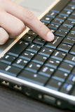 Finger on enter key Royalty Free Stock Image