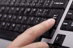 Finger on the enter key Royalty Free Stock Images