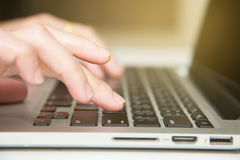 Finger and enter keyboard Stock Photography