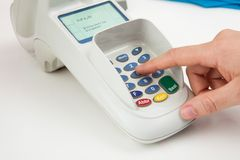 Finger entering the pin code in card reader machine Royalty Free Stock Photo