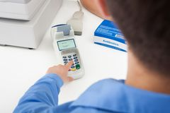 Finger Entering The Pin Code In Card Reader Machine Royalty Free Stock Photography