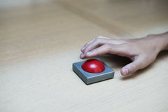 Free Finger Extended Press The Red Button On Wood Table. Stock Images - 79619984