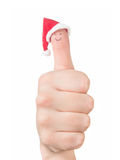 Finger face in Santa hat. Concept for Christmas day. Stock Image
