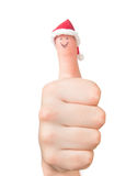 Finger face in Santa hat. Concept for Christmas day. Stock Photo
