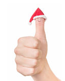Finger face in Santa hat. Concept for Christmas day. Isolated on Royalty Free Stock Images