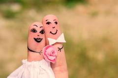 Finger Family. Bride and groom. Funny men painted on the fingers. Newlyweds. Wedding Stock Photography