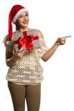 Finger feliz del punto de la sonrisa de la mujer que muestra el espacio vacío lateral de la copia, yo Imagen de archivo libre de regalías