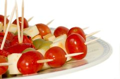 Finger food. Display of tomatoes, cheese, olives and peppers Royalty Free Stock Photos