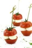 Finger food. Cherry tomatoes with mozzarella Stock Image