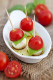 Finger food. Appetizer, finger food - tomato, mozzarella, basil Stock Photo