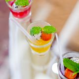 Finger food, dessert and fruits cocktail Royalty Free Stock Image