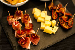 Finger food for evening aperitif. Aperitif with finger food, speck and cheese at the buffet stock images
