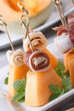 Finger food: ham and melon on skewers vertical Stock Image