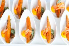 Finger food. A lot of cold finger food snacks with carrots Stock Image