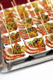 Finger food - meat in small bowls royalty free stock photo