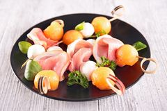 Finger food with melon, Stock Photography