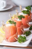 Finger food. Rolls of salmon closeup on the table vertical Royalty Free Stock Photo