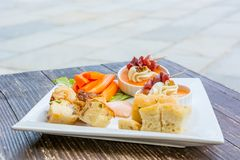 Finger food on wooden table. Stock Image