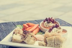 Finger food on wooden table. Stock Photos