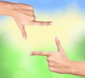 Finger frame over bright nature Stock Photo