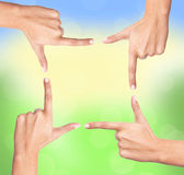 Finger frame over bright nature Royalty Free Stock Images