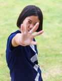 Finger fronting shy girl. Royalty Free Stock Photography