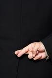 Finger gekreuzt Stockfotografie