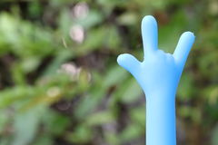 Finger Gesture Called I Love You. Its a blue finger gesture which is meant I Love You Royalty Free Stock Photography
