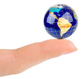 Finger and globe Stock Photos