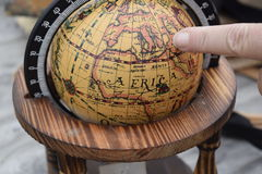 Pointing to a globe Stock Photography