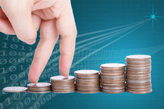 Finger go up to the top of stack coin with Clipping path Royalty Free Stock Photo