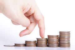 Finger go up to the top of stack coin - Money growing concept Stock Photo