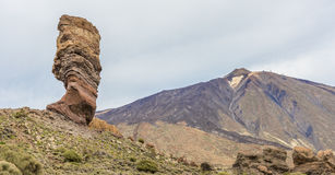 The finger of God at the foot of the Teide volcano. Rock the Finger of God in a rocky valley at the foot of the volcano Teide on Tenerife. Spain Royalty Free Stock Image