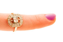 Finger with golden ring isolated Royalty Free Stock Photos