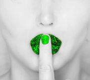 Finger on green glossy lips Stock Images