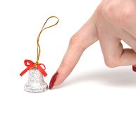 Finger and hand bell. On white Royalty Free Stock Photos