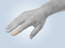 Finger with Healing plaster. Stock Images
