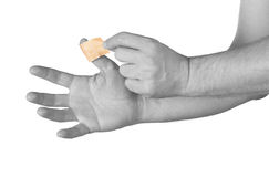 Finger with Healing plaster. Stock Photo