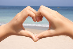 Finger heart. A finger heart on the beach Royalty Free Stock Images