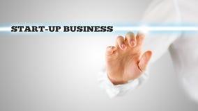 Finger Highlighting Startup Business Words Stock Photo